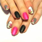 Matte pink and black hibiscus manicure